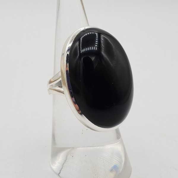 Zilveren ring gezet met grote brede ovale zwarte Onyx 16.5 mm