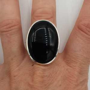 Zilveren ring gezet met grote brede ovale zwarte Onyx 19 mm