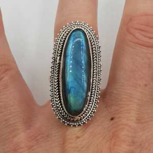 A silver ring set with an oval Labradorite