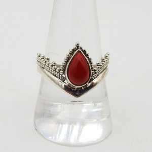 A silver ring set with Coral (19 mm)