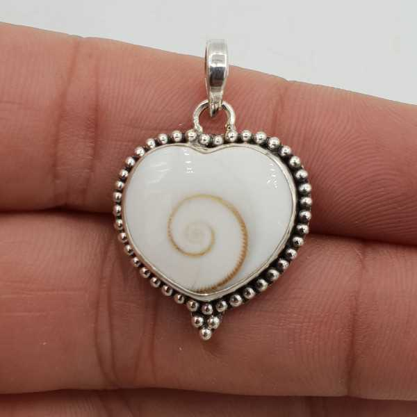 A silver pendant with a heart shaped Shiva shell and
