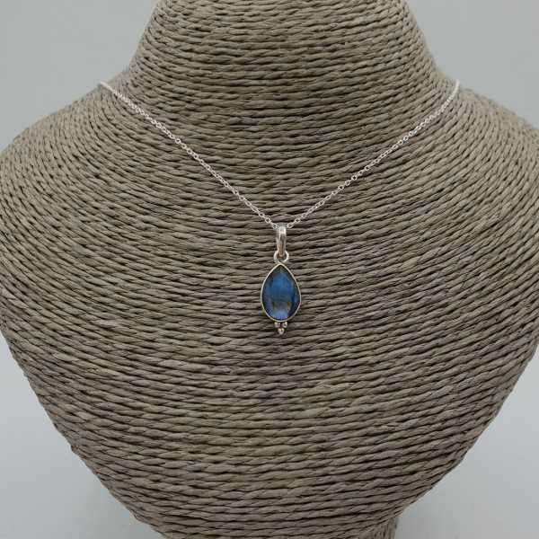 A silver necklace with a Labradorite pendant