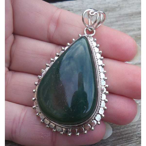 Silver pendant drop shape Nephriet Jade set in a carved setting