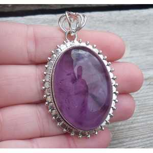 Silver pendant with large oval cabochon Amethyst