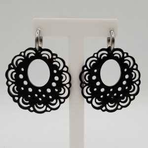 Creoles with a carved black buffalo horn pendant