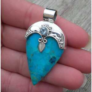Silver pendant set with Turquoise and blue Topaz