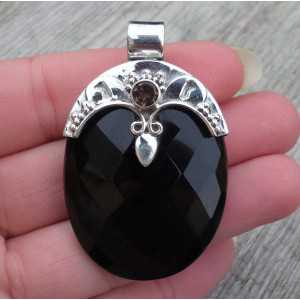 Silver pendant set with oval faceted Onyx and round Smokey Topaz