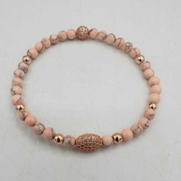 Armband van roze Howliet