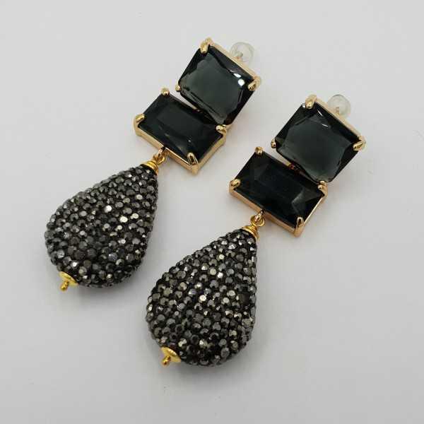 Goud vergulde oorbellen met kristal en druppel van zwarte kistallen