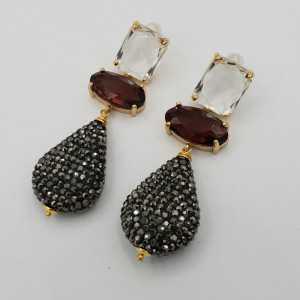 Goud vergulde oorbellen kristal en druppel van zwarte kistallen