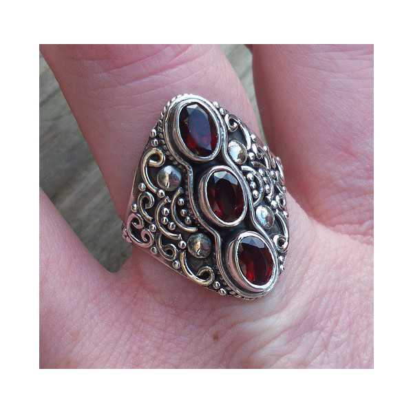 Silver ring set with three facet Grenades 18.5 mm