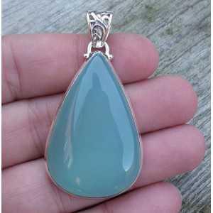 Silver pendant set with oval shape aqua Chalcedony