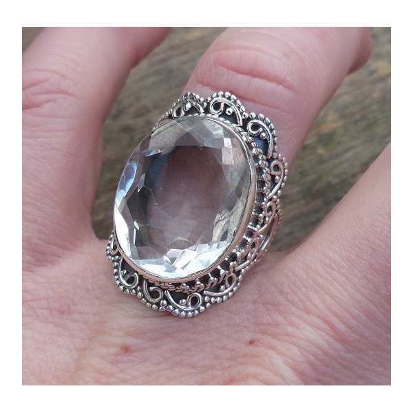 Silver ring set with white Topaz and crafted head 17 mm