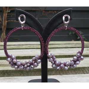 Zilveren oorbellen met hanger van zijdedraad en kristallen