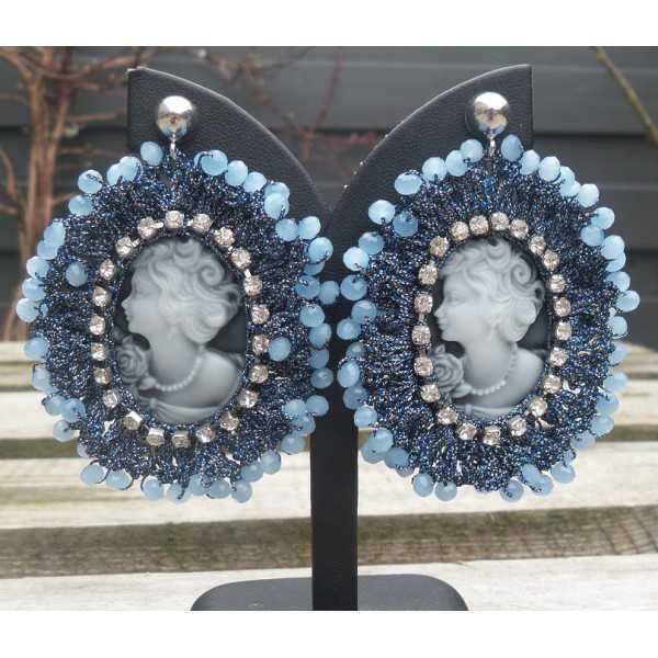 Silver earrings with cameo pendant of silk thread and crystal blue