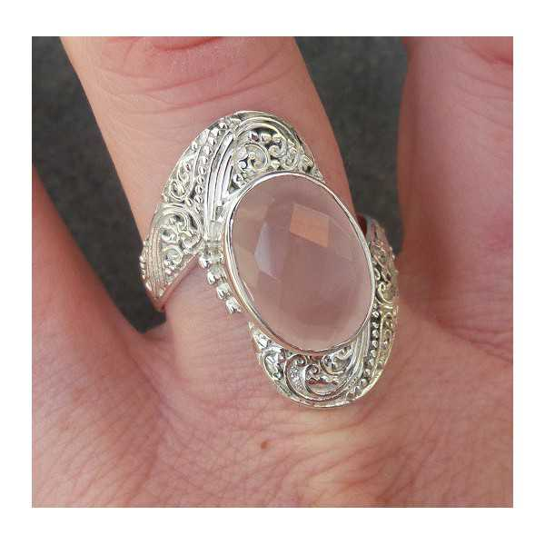 Silver ring set with oval facet cut rose quartz