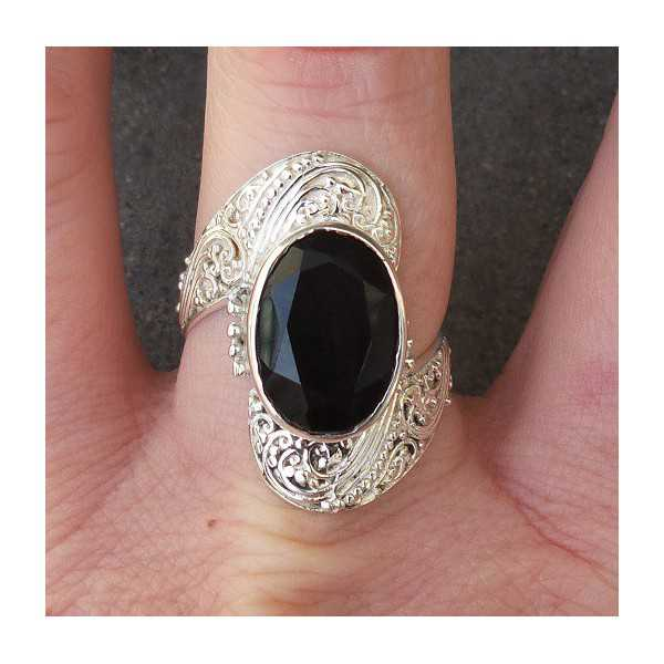 Silver ring set with oval facet cut Onyx 18 mm