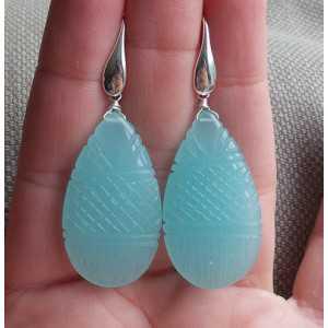 Zilveren oorbellen met uitgesneden Chalcedoon
