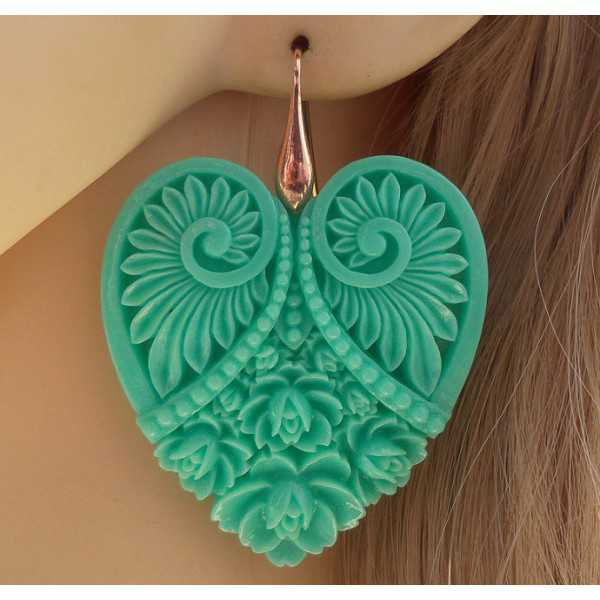Vergoldete Ohrringe mit cut-out-Herz mint grün