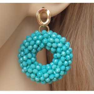 Vergulde oorbellen ronde hanger van Turkoois kleurige Kristallen