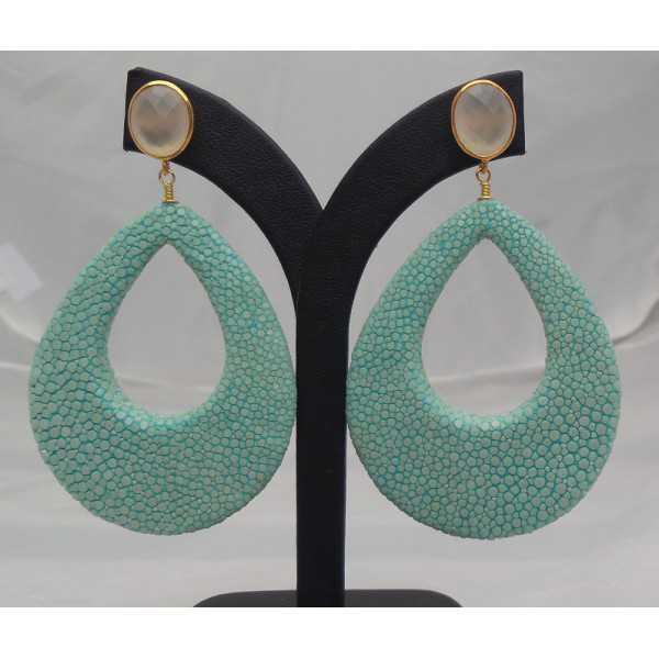 Vergulde oorbellen duppel van Turkoois blauwe Roggenleer en witte Onyx