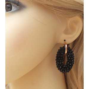 Rosé vergulde creolen met ovale hanger van zwarte Onyxen