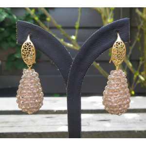 Vergulde oorbellen met druppel van champagne kleurige kristallen