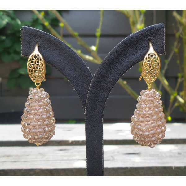 Gold plated earrings with a drop of champagne colored crystals