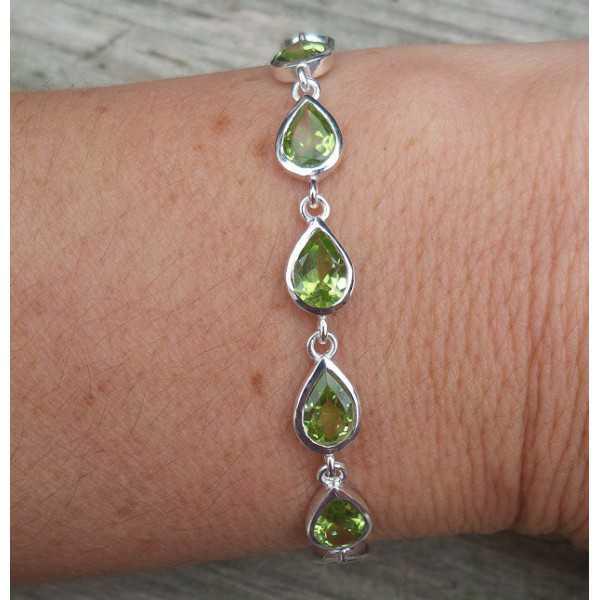 Silver bracelet set with teardrop faceted Peridot