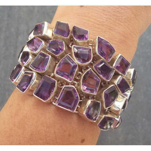 Silver bracelet set with facet cut Amethisten