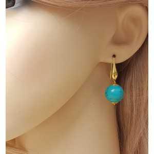 Vergulde oorbellen met ronde Turkoois
