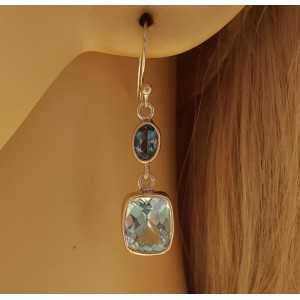 Zilveren oorbellen gezet met rechthoekige en ovale blauw Topaas