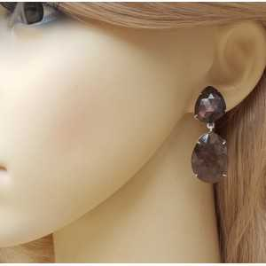 Silver earrings set with brown Sapphires