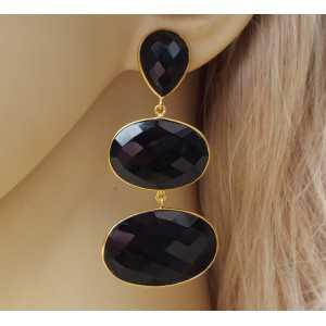 Goud vergulde oorbellen gezet met zwarte Onyxen