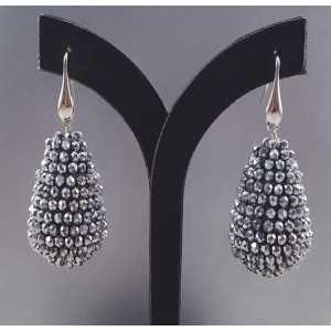 Zilveren oorbellen met grote druppel van zilveren kristallen