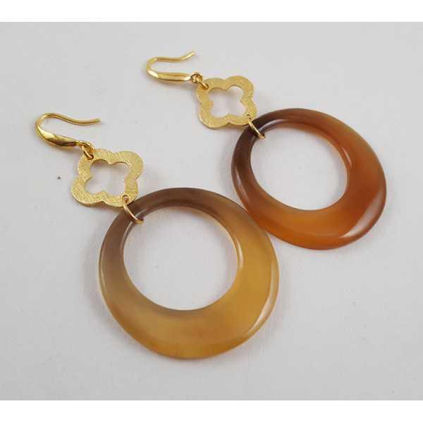 Vergulde oorbellen met ring van Buffelhoorn en gouden klaver