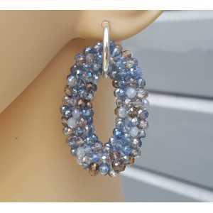 Zilveren creolen met ovale hanger van blauw grijze kristallen