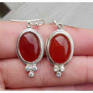 Zilveren oorbellen gezet met Carneool en Zirkonia