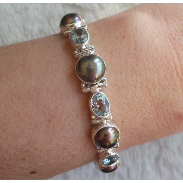 Zilveren armband gezet met blauw Topaas en grijze Parel
