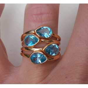 Vergulde ring gezet met vier blauwe Topazen maat 17.3 mm