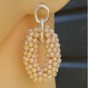 Zilveren oorbellen met ovale hanger van ivoor witte kristallen