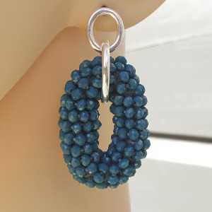 Zilveren oorbellen met jeans blauwe ovale hanger van kristallen