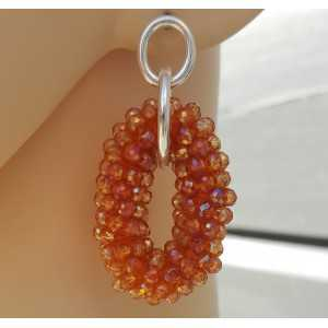 Zilveren oorbellen met ovale hanger van oranje kristallen