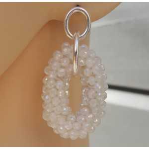 Zilveren oorbellen met ovale hanger van witte kristallen