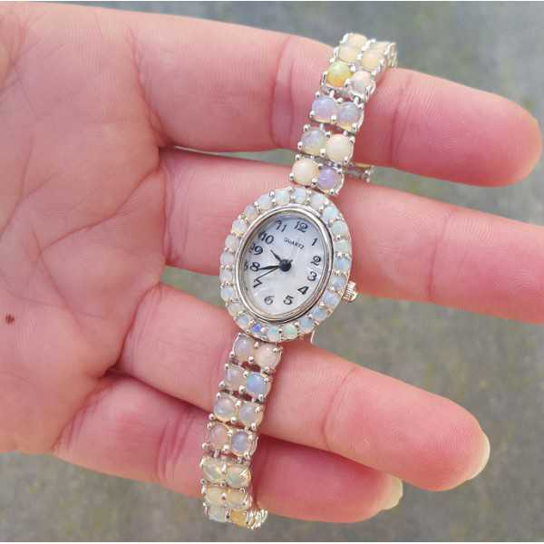 Silver watch set with round cabochon Ethiopian Opals