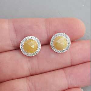 Zilveren oorknoppen gezet met gele Saffier en Zirkonia