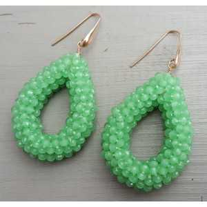 Earrings with open drop of apple green crystals